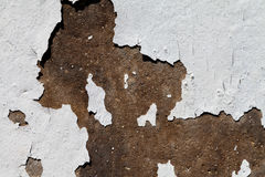 Cracked white colour on a stone wall Royalty Free Stock Images