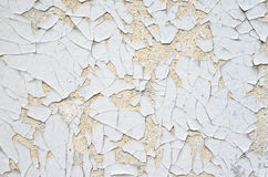 Cracked white and orange paint on a wall Stock Image