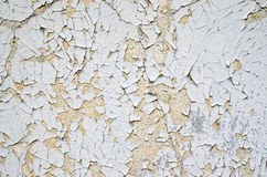 Cracked white and orange paint on a wall Stock Photography
