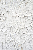 Cracked white paint on a wall Royalty Free Stock Photos