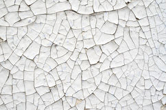 Cracked white paint on a wall Stock Photography