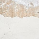 Cracked whitewash wall fragment Royalty Free Stock Photos