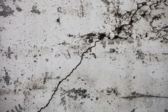 Cracked whitewashed wall with rich and various texture Stock Photos