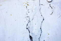 Cracked whitewashed wall with rich and various texture Royalty Free Stock Photo