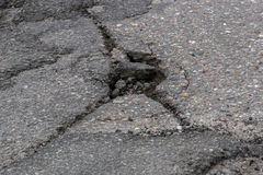 Cracked whole in the asphalt road Royalty Free Stock Photo
