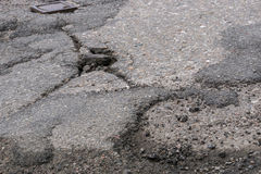 Cracked whole in the asphalt road Royalty Free Stock Photos