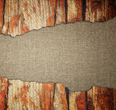 Cracked wood board over canvas background Stock Photography