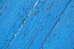 Cracked wooden surface  blue background Royalty Free Stock Image