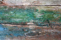 Cracked wooden texture. Hardwood pattern with green and blue paint. macro view Royalty Free Stock Photos