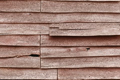 Cracked wooden wall. The old wooden wall is cracked and broken, even the hole can be seen here stock photos