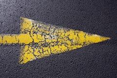 Cracked yellow arrow Royalty Free Stock Photos