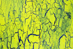Cracked yellow paint on the blue surface Royalty Free Stock Photos