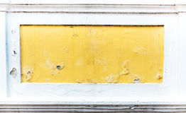 Cracked yellow paint color concrete wall,texture background Stock Photos