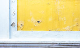 Cracked yellow paint color concrete wall,texture background Royalty Free Stock Photos