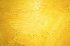 Cracked yellow paint on wall. Old exterior surface texture. Architecture concept royalty free stock image