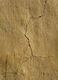 Cracked yellow plaster wall Stock Images
