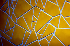 Cracked yellow tiles Stock Images