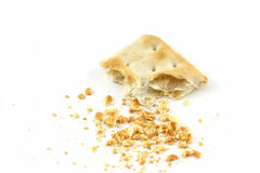 Cracker with a bite and crumb isolated. On white background Royalty Free Stock Photo
