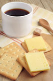 Cracker with cheese and coffee Stock Image