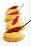 Cracker with cheese cream, garnished with red pepperoni Stock Photos