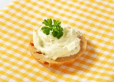 Cracker with cheese spread. Round cracker with cream cheese spread Stock Photos