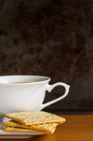 Cracker with coffee. Whole wheat cracker with cup coffee Stock Image