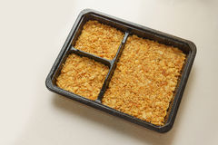Cracker crust in the box. Cracker crust in the square box Royalty Free Stock Images
