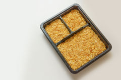 Cracker crust in the box. Cracker crust in the square box Stock Photos