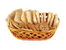 Cracker del grano, grano del riso, biscotti e grani di grano su fondo bianco Fotografia Stock