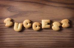 Cracker des Erfolgs Stockbild