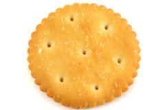 Cracker flat. One salty cracker flat on white royalty free stock image