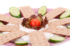 Cracker with fresh vegetables and cream. On pink plate Stock Photos