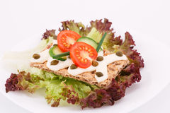Cracker with fresh vegetables and cream. On plate Stock Photo