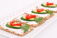 Cracker with fresh vegetables and cream Stock Photo