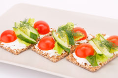 Cracker with fresh vegetables and cream Royalty Free Stock Photo