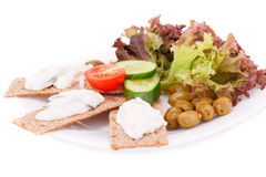 Cracker with fresh vegetables and cream. On plate isolated on white background Royalty Free Stock Image