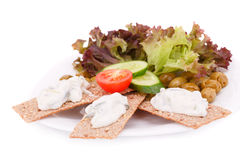 Cracker with fresh vegetables and cream Stock Photography