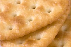 Cracker Macro. Macro of three salted crackers revealing texture and detail Royalty Free Stock Image