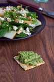 Cracker with pesto Stock Photo