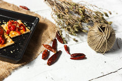Cracker with roasted peppers, chili pepper and oregano Stock Photography