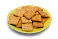 Cracker on saucer Stock Photos