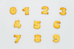 Cracker in shape of number with white background. 1 Stock Photo