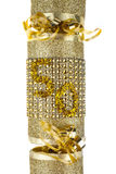50 Cracker. A shot of a 50th Birthday or Anniversary Cracker also known as a Bon Bon.  A cracker consists of a cardboard tube wrapped in a brightly decorated Royalty Free Stock Photo