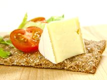 Cracker with soft cheese and tomato Stock Photo