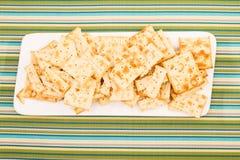Cracker su un piatto Immagini Stock
