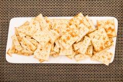 Cracker su un piatto Fotografia Stock