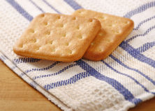 Cracker. Two pieces of salty cracker on a linen napkin royalty free stock photo