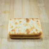 Cracker on wooden Royalty Free Stock Image