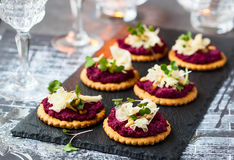 Crackers with beet pesto and cheese Stock Image