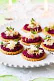 Crackers with beet pesto and cheese Royalty Free Stock Image